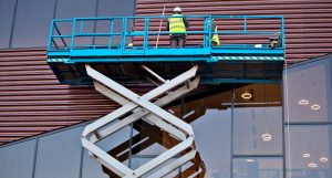 Builder on a Scissor Lift Platform at a construction site