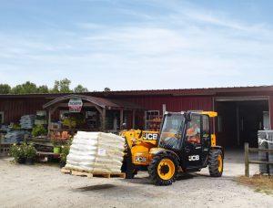 jcb moving heavy equipment