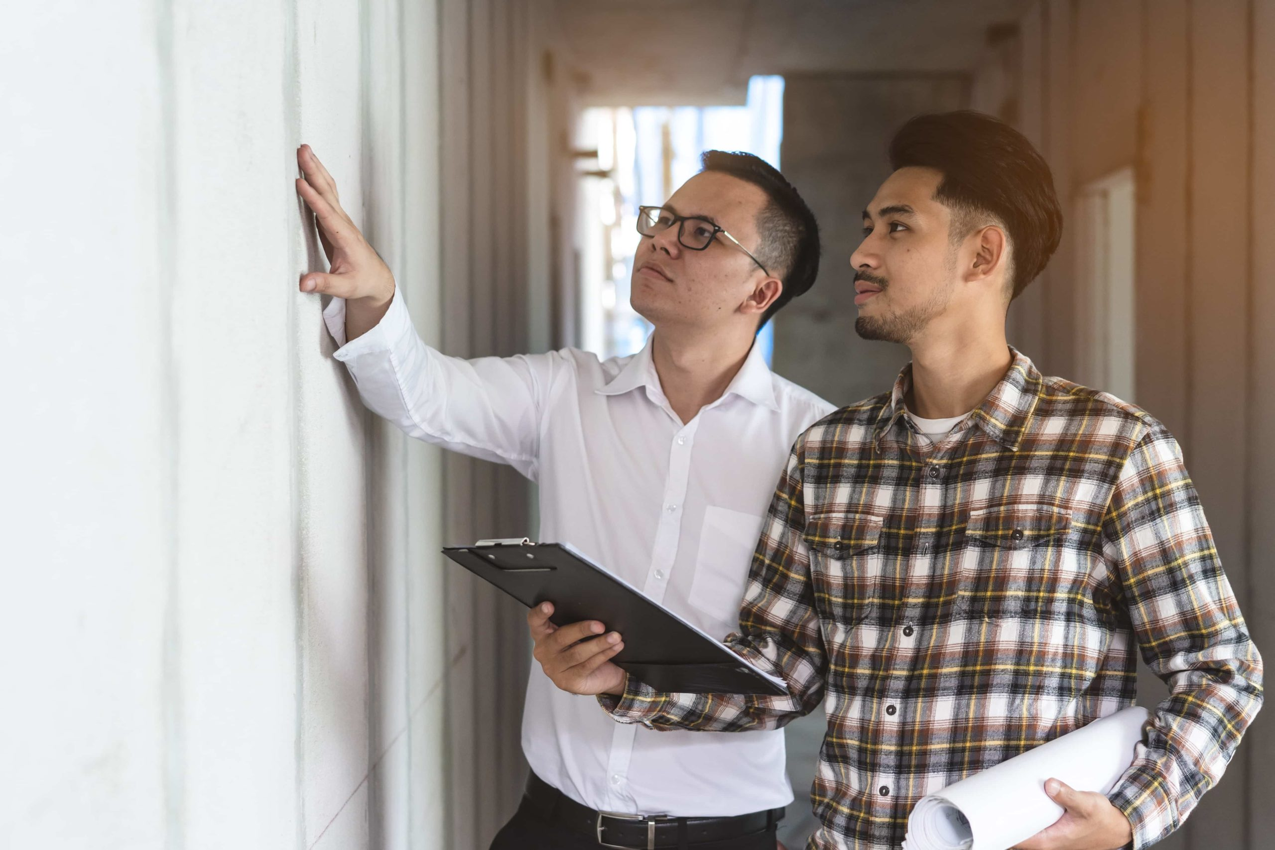 Builder inspection consultancy. Two engineer consulting and checking material and structure in construction.