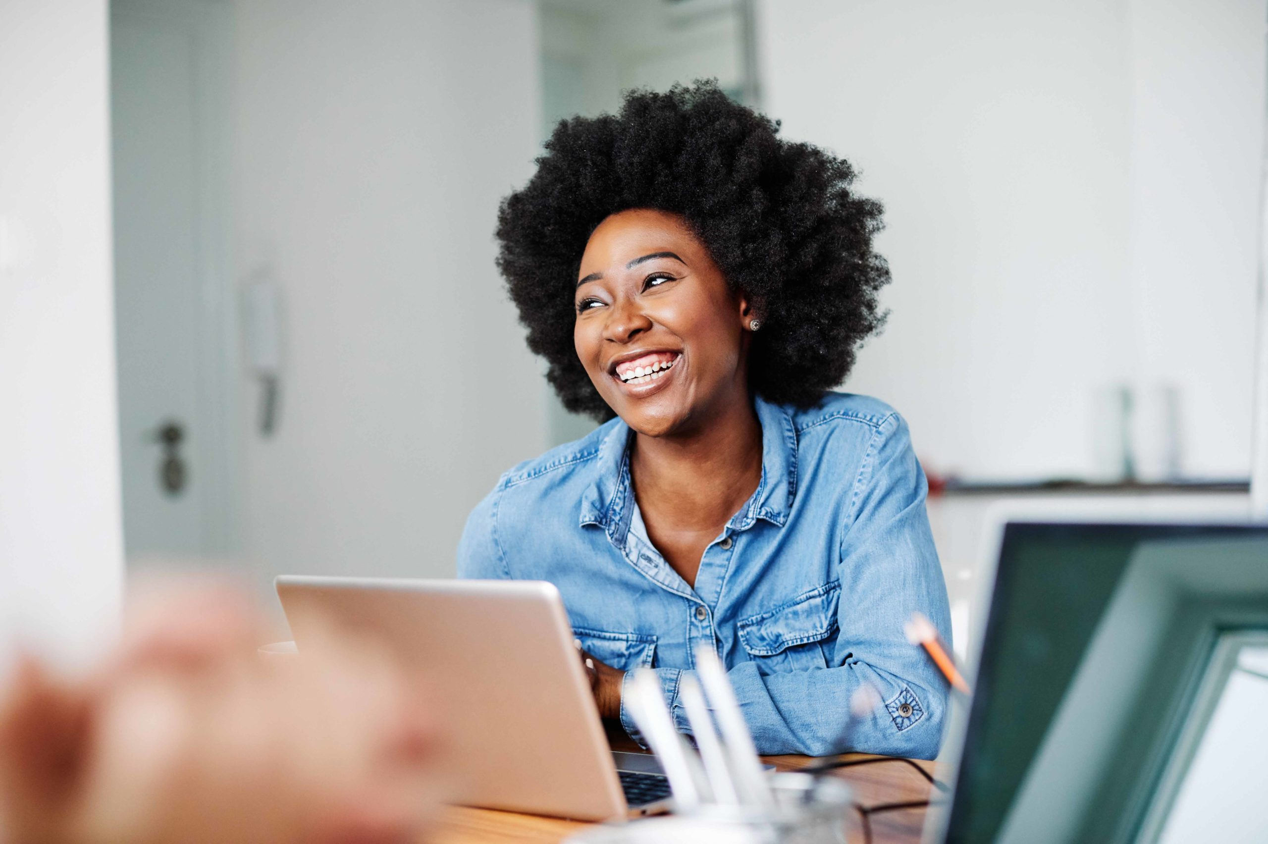 Attractive african american business woman in a modern office or a student in a classroom